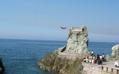The Bird Men of Mazatlan: Cliff divers wait for tide to come in, Mariner