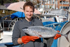 Chef Ned Bell of the Four Seasons' YEW restaurant, buys sustainable fish at the city's wharf.