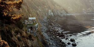 Esalen's wooden buildings perch on ledges along California's Big Sur coast.