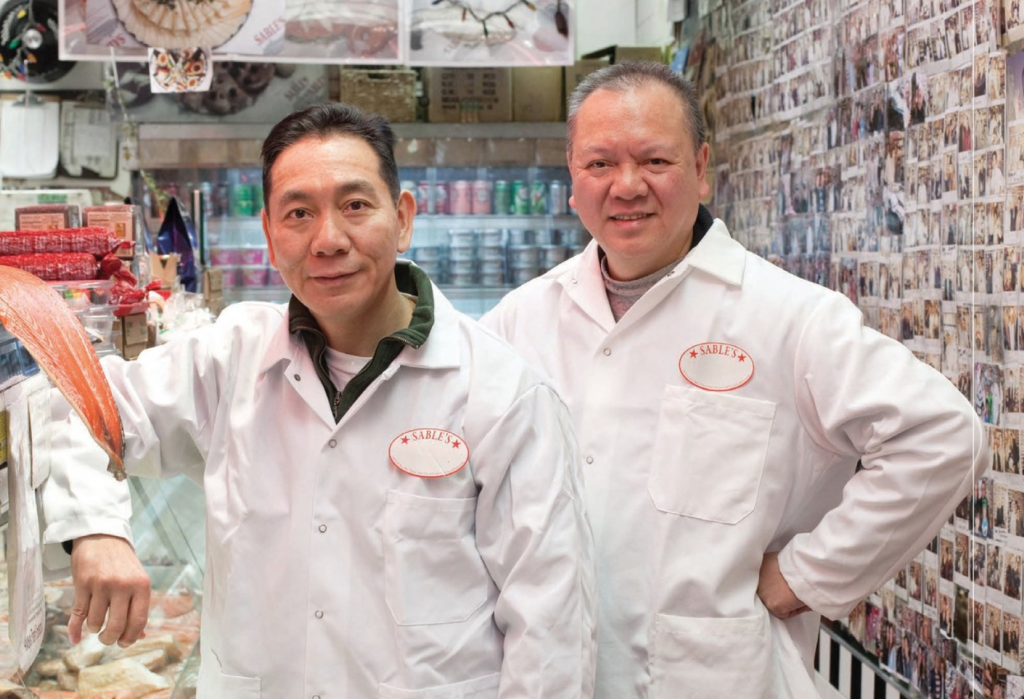 Immigrants Kenny and Danny Sze trained at Zabar's and now how their own smoked fish emporium on NYC's upper east side.